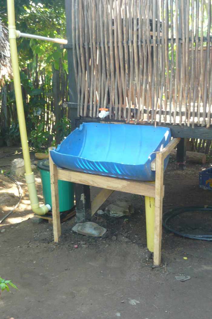 Wash basin connected to rainwater collection system