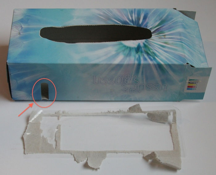 The tissue box of Albert Heijn has a large plastic foil glued to the inside of the box to cover the tiny window.